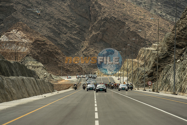 The peloton in action during Stage 4 of 10th Tour of Oman 2019, running 131km from Yiti (Al Sifah) to Oman Convention and Exhibition Centre, Oman. 19th February 2019.<br /> Picture: ASO/Kåre Dehlie Thorstad | Cyclefile<br /> All photos usage must carry mandatory copyright credit (© Cyclefile | ASO/Kåre Dehlie Thorstad)