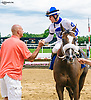 Scott Lake congratulating Jomar Torres after winning aboard She's Thirsty at Delaware Park on 6/8/17