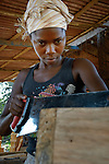 Patricia Toe at work in a carpenter's shop in Buchanan, Liberia. The young woman is a graduate of the skills training program at the Brighter Future Children Rescue Center in Buchanan. Supported by the United Methodist Church in Germany and United Methodist Women, the center carries out rehabilitation work with ex-combatants and other war-affected children.