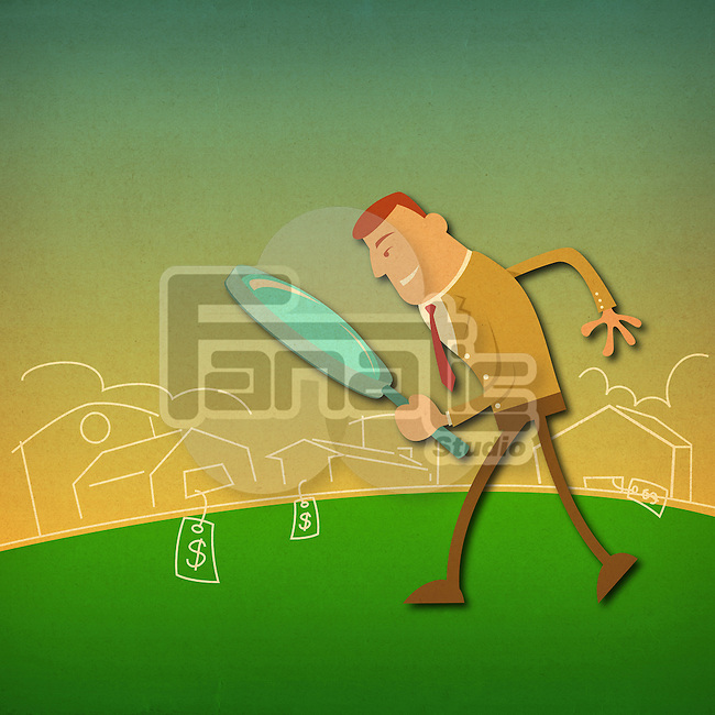 Businessman looking homes through a magnifying glass