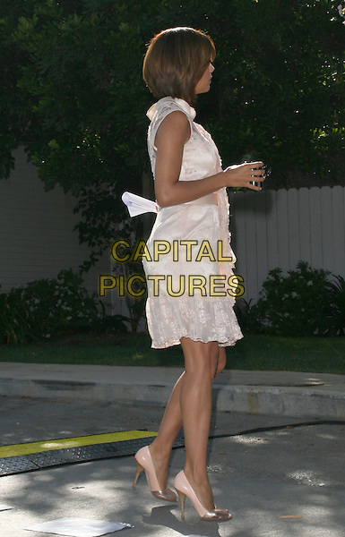 EVA LONGORIA PARKER .2008 ALMA Awards Nominees Press Conference  held on Wisteria Lane at Universal Studios Backlot, Universal City, California, USA, .21 July 2008..full length peach lace pale pink dress sheer bob ruffle slip satin shoes profile side heels shoes walking .CAP/ADM/FS.©Faye Sadou/Admedia/Capital Pictures