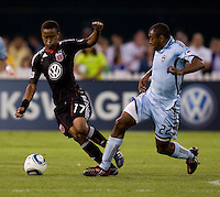 Thabiso Khumalo (17) of D.C. United takes the ball away from Marvell Wynne (22) of the Colorado Rapids at RFK Stadium in Washington, DC.  The Colorado Rapids defeated D.C. United, 1-0.