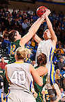 BROOKINGS, SD - FEBRUARY 22:  Megan Waytashek #24 from South Dakota State University shoots over the defense of Marena Whittle #32 from North Dakota State University in the first half of their game Saturday afternoon at Frost Arena in Brookings.  (Photo by Dave Eggen/Inertia)