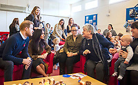 06/11/2019 - Meghan Markle Duchess of Sussex and Prince Harry Duke of Sussex, speaking to members of the families of serving soldiers, during a visit to Broom Farm Community Centre in Windsor. The Duke and Duchess of Sussex attended a coffee morning with families of deployed Army personnel at the Centre. Photo Credit: ALPR/AdMedia
