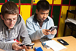 Education High School two male students using graphing calculators