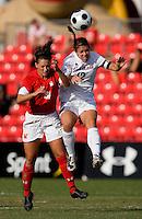 Santa Clara midfielder (12) Kendra Perry goes up for a header against Maryland midfielder (34) Danielle Hubka.  Maryland defeated Santa Clara, 1-0, at Ludwig Field in College Park Maryland.