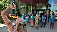 Lincoln Elementary hosts celebration to dedicate the artwork &quot;Elephant&quot; by Stefanie Gutheil. <br /> <br /> Cirque Louis performer Jessica Marquardt demonstrates fire eating to students.
