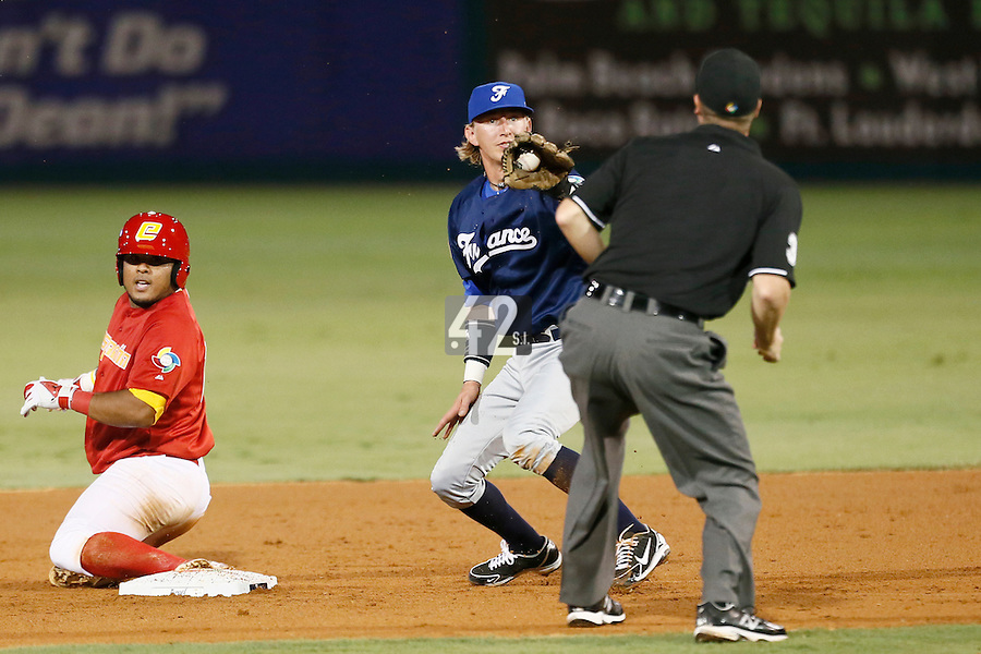 20 September 2012: Luc Piquet tags out a spain player during Spain 8-0 win over France, at the 2012 World Baseball Classic Qualifier round, in Jupiter, Florida, USA.
