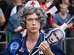 © Joel Goodman - 07973 332324 . 24 August 2013 . Manchester , UK . Vladimir Putin protest . 2013 Gay Pride Parade through Manchester City Centre . This year's theme is 1980s . Photo credit : Joel Goodman