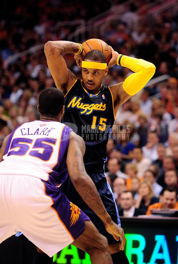 Apr. 13, 2010; Phoenix, AZ, USA; Denver Nuggets forward Carmelo Anthony against the Phoenix Suns at the US Airways Center. The Suns defeated the Nuggets 120-101. Mandatory Credit: Mark J. Rebilas-