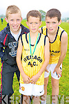 Adam O'Dwyer, Niall O'Shea and Ronan O'Shea, Iveragh AC, enjoying the County uneven age intermediate and masters championship in Beaufort on Sunday.