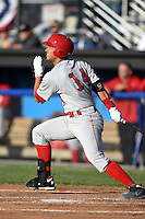 Auburn Doubledays first baseman Jose Marmolejos-Diaz (14) during a game against the Batavia Muckdogs on June 14, 2014 at Dwyer Stadium in Batavia, New York.  Batavia defeated Auburn 7-2.  (Mike Janes/Four Seam Images)