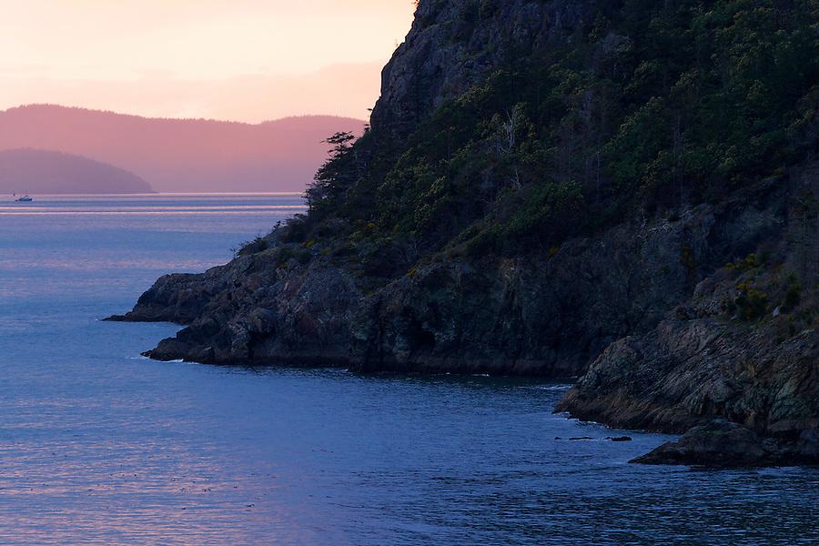Cliff along Rosario Bay at sunset, Fidalgo Island, Deception Pass State Park, Island County, Washington, USA