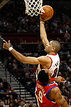 12/26/11--Trail Blazers forward Nicolas Batum makes a layup over 76ers' Andre Iguodala in the home-opener at the Rose Garden...Photo by Jaime Valdez. .........................................