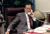 United States President George H.W. Bush speaks by telephone to President Mikhail Gorbachev of the Soviet Union following his call to Chancellor Helmut Kohl of Germany from the White House in Washington, DC on July 17, 1990<br /> Mandatory Credit: Carol T. Powers / White House via CNP