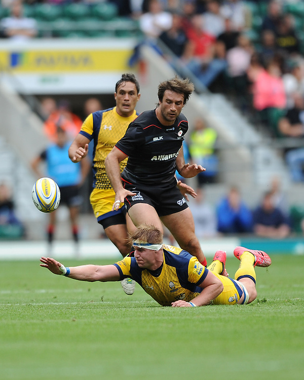 GJ van Velze of Worcester Warriors grasps for a loose ball as Marcelo Bosch of Saracens joins the action during the Aviva Premiership Rugby match between Saracens and Worcester Warriors at Twickenham Stadium on Saturday 03 September 2016 (Photo by Rob Munro/Stewart Communications)