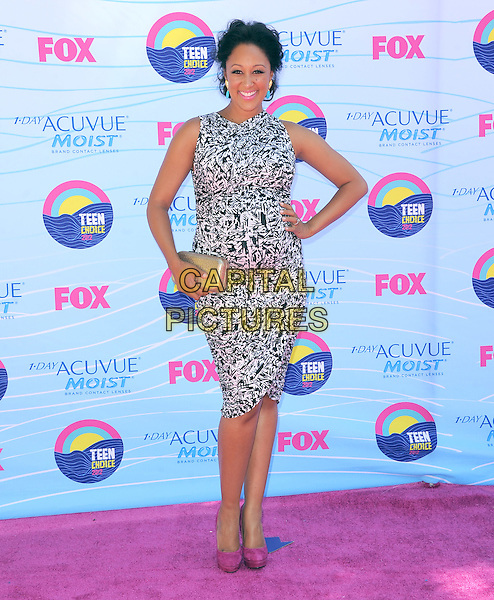 Tamera Mowry.FOX's 2012 Teen Choice Awards held at The Gibson Ampitheatre in Universal City, California, USA..July 22nd, 2012.full length black white dress clutch bag hand on hip pregnant pink shoes gold sleeveless .CAP/RKE/DVS.©DVS/RockinExposures/Capital Pictures.