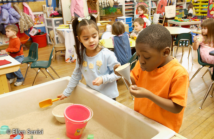 MR / Schenectady, NY                                  .Yates Arts-in-Education Magnet School (urban school).Pre-Kindergarten classroom; NYS Universal Pre-K Program.Students play at sand table at free play time ( Girl: 4, Puerto-Rican American; Boy: 4, African-American)..Val1   Far2.©Ellen B. Senisi