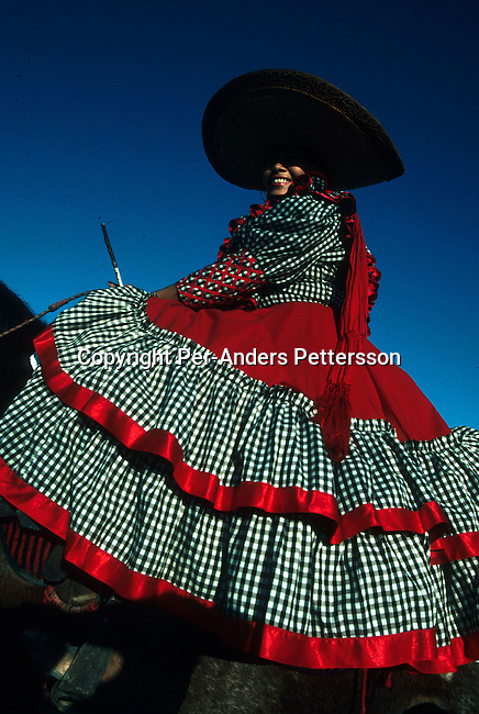 An unidentified women in traditional clothing on a horse on September 16, 1999, in Nuevo Laredo, Mexico. Mexicans celebrated Independence Day on September 16 and the entire country are watching parades and fireworks..(Photo: Per-Anders Pettersson/ Getty Images)