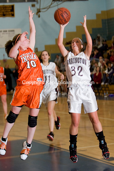 WATERBURY, CT - 23 FEBRUARY 2009 -022309JT04-<br /> Torrington's Lindsey Begey takes a shot while under pressure from Watertown's Kelly Blake during Monday's NVL semifinal game at Kennedy. The Raiders won, 53-31.<br /> Josalee Thrift Republican-American