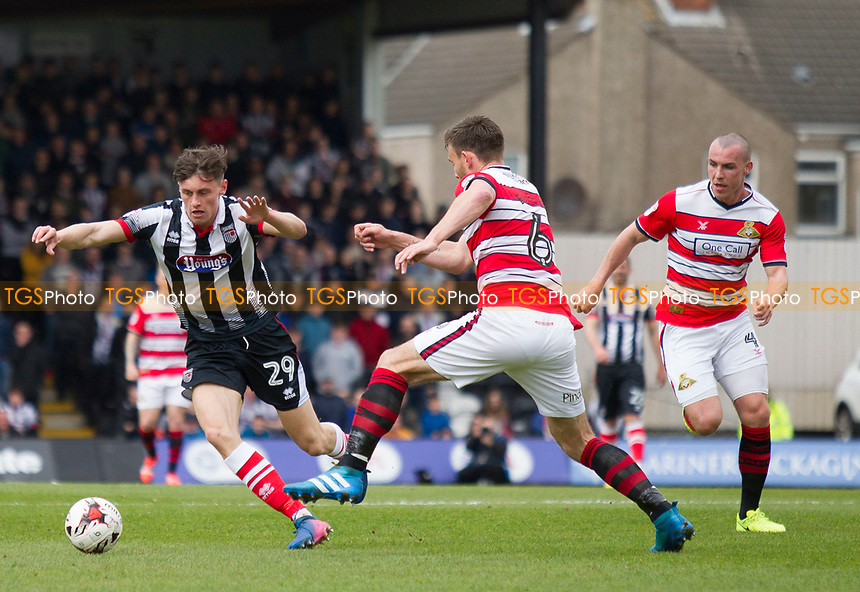 Calum Dyson of Grimsby T and Andrew Butler of Doncaster Rovers during Grimsby Town vs Doncaster Rovers, Sky Bet EFL League 2 Football at Blundell Park on 1st April 2017