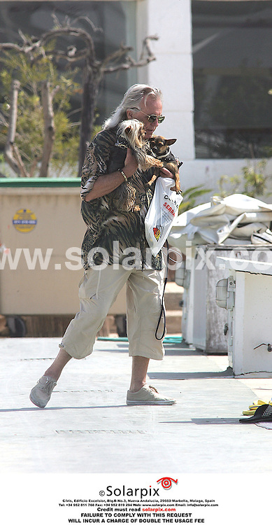 ALL ROUND PICTURES FROM SOLARPIX.COM.*MUST CREDIT SOLARPIX.COM OR DOUBLE FEE WILL BE CHARGED*.Peter Stringfellow the night club Casanova plying his new roll the salty sea dog, taking his two dogs for a walk around the the port where his yaht is moored in the Spanish Mediterranean...DATE:05.07.06-JOB REF:2544-MSR