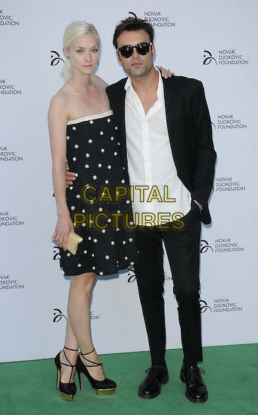 Portia Freeman &amp; Pete Denton<br /> Novak Djokovic Foundation Gala Dinner at the Roundhouse, Chalk Farm, London, England.<br /> July 8th 2013<br /> full length suit sunglasses shades strapless dress polka dot black white <br /> CAP/CAN<br /> &copy;Can Nguyen/Capital Pictures
