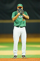 Daniel Miranda #37 of the Miami Hurricanes looks to his catcher for the sign against the Wake Forest Demon Deacons at Gene Hooks Field on March 18, 2011 in Winston-Salem, North Carolina.  Photo by Brian Westerholt / Four Seam Images