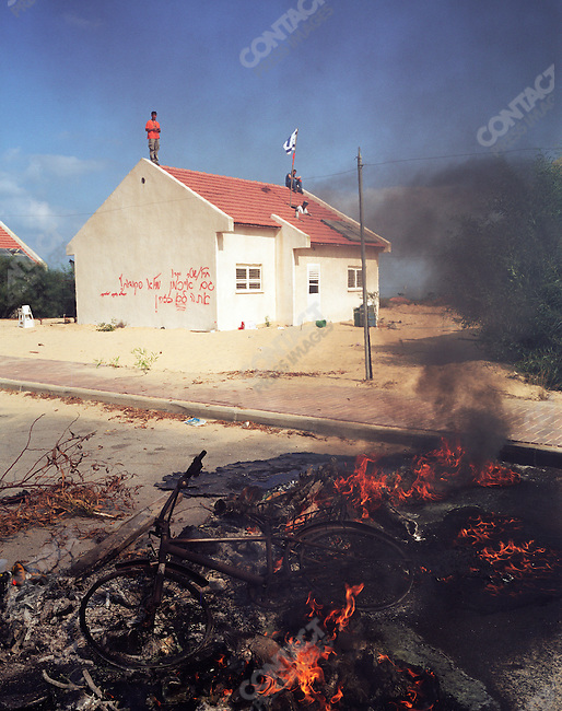 Israel's pullout from the Gaza Strip, Settlers are removed from the Gush Katif settlement by Israeli Defense Forces, August 2005