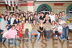 KEY OF THE DOOR: Celebrating joint 21st birthdays in The River Island Hotel, Castleisland, on Saturday evening were Elaine Lyons and Billy Cronin of Castleisland (seated centre) along with family and friends..