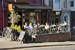 People sitting outside cafe bar, Oystermouth, Mumbles, Gower peninsula, near Swansea, South Wales, UK