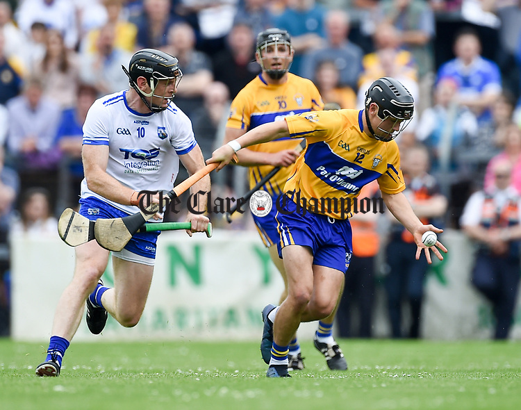 Kevin Moran of Waterford in action against David Reidy of Clare during their Munster  championship round robin game at Cusack Park Photograph by John Kelly.