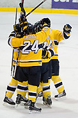 The Warriors celebrate Brodhag's goal which stood as the gamewinner. - The Merrimack College Warriors defeated the Boston College Eagles 5-3 on Sunday, November 1, 2009, at Lawler Arena in North Andover, Massachusetts splitting the weekend series.