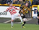 Hamilton's James Keatings and Alloa's Michael Doyle challenge for the ball.