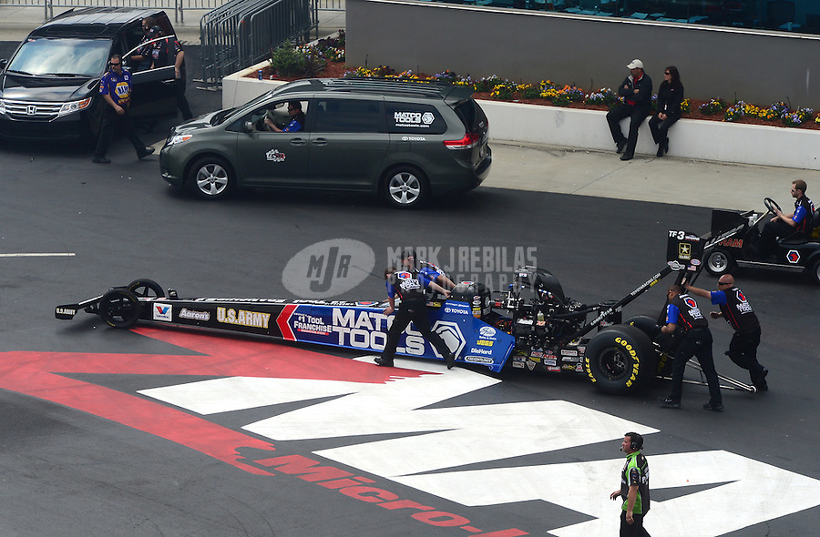 Apr. 15, 2012; Concord, NC, USA: NHRA crew members for top fuel dragster driver Antron Brown during eliminations for the Four Wide Nationals at zMax Dragway. Mandatory Credit: Mark J. Rebilas-