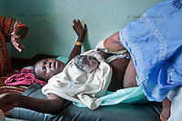 Wileza Itun and her newborn baby minutes after delivery in Arua Hospital, Uganda.