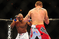 Oct. 29, 2011; Las Vegas, NV, USA; UFC fighter Clifford Starks (left) against Dustin Jacoby during a middleweight bout during UFC 137 at the Mandalay Bay event center. Mandatory Credit: Mark J. Rebilas-