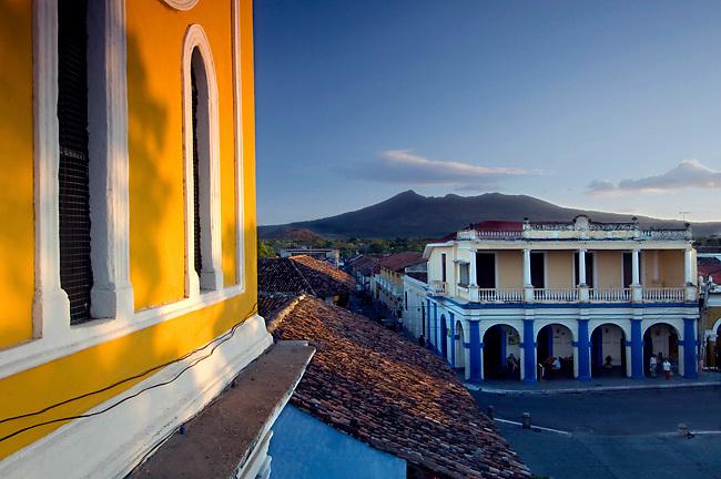 The Mombacho Volcano rises above the Colonial architecture of Granada, Nicaragua.