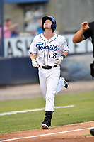 Asheville Tourists second baseman Taylor Snyder (28) after hitting a home run during a game against the Rome Braves at McCormick Field on August 31, 2018 in Asheville, North Carolina. The Braves defeated the Tourists 11-7. (Tony Farlow/Four Seam Images)