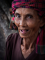 Portrait of an elderly Khmer women who collects plastic bottles left by tourists at Angkor Wat, Cambodia