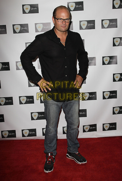CHRIS BAUER.'True Blood' Chris Bauer Visits Gifitng services held at Gifting Services showroom, West Hollywood, CA, USA..June 15th, 2010.full length shirt black glasses hands on hips jeans denim.CAP/ADM/KB.©Kevan Brooks/AdMedia/Capital Pictures.