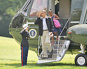 Washington, D.C. - September 6, 2009 -- United States President Barack Obama salutes to the Marine Guard as he and his family return to the White House aboard Marine 1 after spending the past few days as Camp David on Sunday, September 6, 2009. Behind him is his daughter Sasha.Credit: Ron Sachs / Pool via CNP
