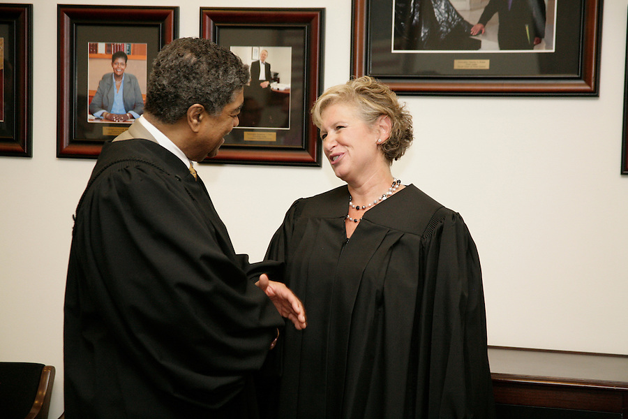 Abbey Fishman Romanek was sworn in as a Cook County judge by Chief Justice Tim Evans on August 4, 2014. Friends and supporter came to see the peak moment after 3 campaigns over 6 years. Having won the Democratic primary in March 2014, she was appointed before the general election. After her swearing in, friends and family celebrated with Abbey.  [Photo by Karen Kring]
