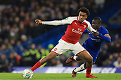 10th January 2018, Stamford Bridge, London, England; Carabao Cup football, semi final, 1st leg, Chelsea versus Arsenal; Alex Iwobi of Arsenal battles with Ngolo Kante of Chelsea