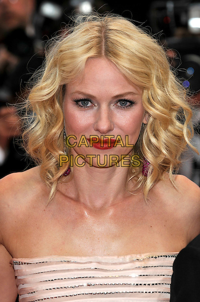 NAOMI WATTS .Attending the screening of 'You Will Meet a Tall Dark Stranger' presented out of competition at the 63rd Cannes Film Festival, Cannes, France, .15th May 2010..premiere portrait headshot red lipstick make-up strapless wavy hair .CAP/PL.©Phil Loftus/Capital Pictures.