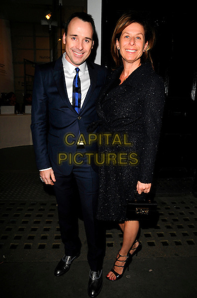 DAVID FURNISH & JO LEVIN.The Deutsche Borse Photography Prize Awards 2008, The Photographers' Gallery, London, England.March 5th, 2008.full length blue suit black coat .CAP/CAN.©Can Nguyen/Capital Pictures.