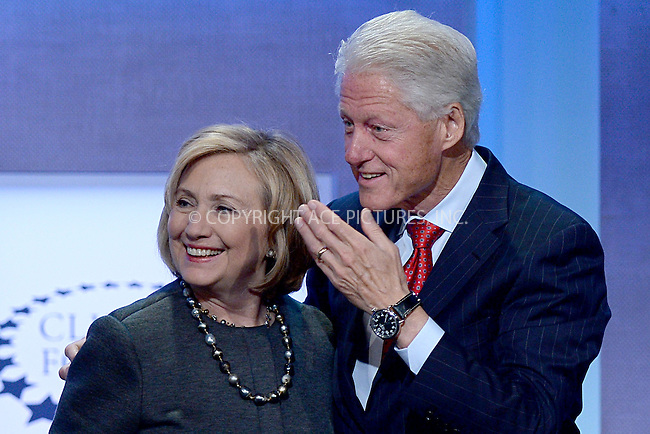 WWW.ACEPIXS.COM<br /> September 22, 2014 New York City<br /> <br /> Hillary Clinton and Bill Clinton during the Opening Plenary Session discussion for the Clinton Global Initiative on September 22, 2014 in New York City.<br /> <br /> <br /> By Line: Kristin Callahan/ACE Pictures<br /> ACE Pictures, Inc.<br /> tel: 646 769 0430<br /> Email: info@acepixs.com<br /> www.acepixs.com