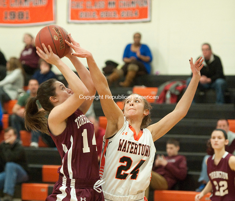 WATERTOWN, CT--- -021716JS13- Torrington's Sidnee Kovall (14) gets fouled by Watertown's Alexis Forte (24) while putting up a shot during their game Wednesday at Watertown High School.<br /> Jim Shannon Republican-American