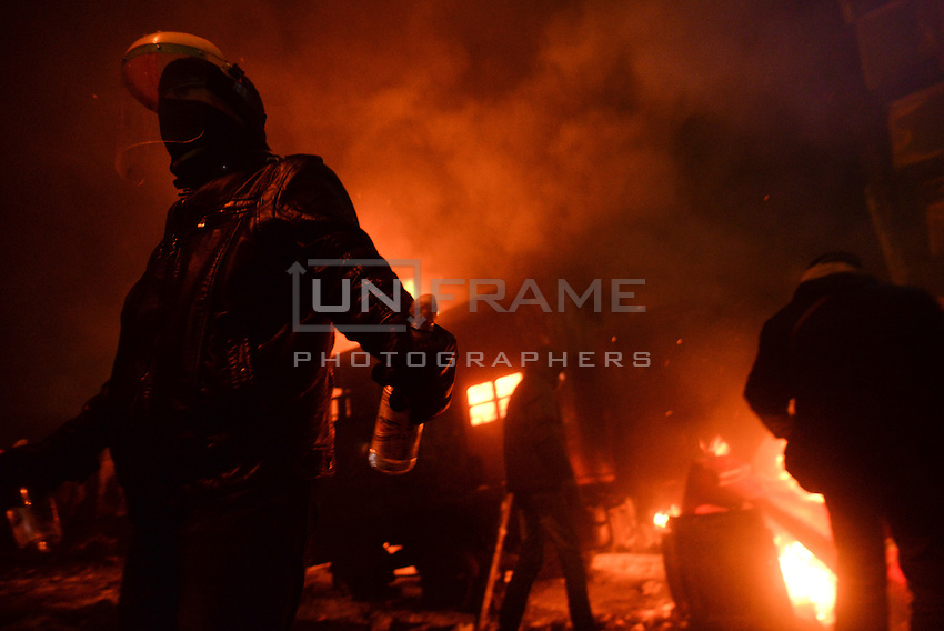 Rioters throw stones and molotov cocktails to torch police trucks during the   protest against new draconian law to ban the right to  protest across the country.  Kiev. Ukraine