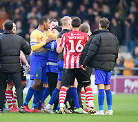 Tempers appear to threaten over at the end of the game<br /> <br /> Photographer Chris Vaughan/CameraSport<br /> <br /> The EFL Sky Bet League Two - Lincoln City v Mansfield Town - Saturday 24th November 2018 - Sincil Bank - Lincoln<br /> <br /> World Copyright &copy; 2018 CameraSport. All rights reserved. 43 Linden Ave. Countesthorpe. Leicester. England. LE8 5PG - Tel: +44 (0) 116 277 4147 - admin@camerasport.com - www.camerasport.com